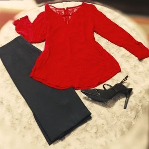 Red blouse with gold zipper and lace detail